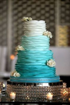 ombre teal wedding cake with white flowers