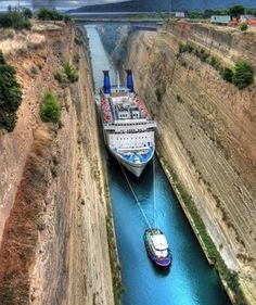 Cruise ship being led thru the canal in Corinth, GREECE!