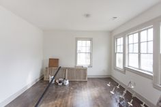walls throughout the house are painted White Dove (flat) and the trim is painted Revere Pewter (semi gloss). The floor is stained Jacobean by Minwax