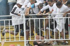 Fans of Rio de Janeiro's Vasco da Gama soccer team attacked a fan of Parana's Atlético Paranaense during a Brazilian Championship soccer mat...