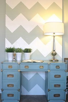 The plywood painted with the chevron looks so cool and its a big statement thats cheap and its not an entire wall that you have to commit to.  Love the desk too