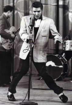 Elvis singing and dancing on stage