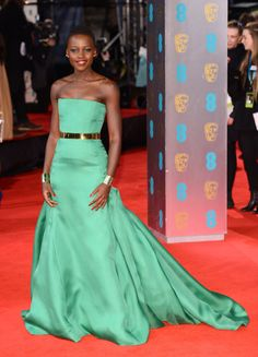 February 16, 2014: February 16, 2014: Lupita Nyong'o wears a bright green Christian Dior Couture ballgown, Christian Louboutin heels and Ana Khouri jewellery to the BAFTAs.
