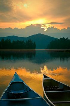 aquieterstorm: Canoes on Lake Placid by photogodfrey on Getty Images