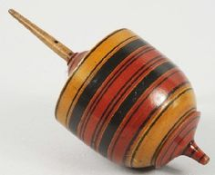 Early Wooden Spinning Top Toy