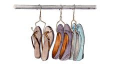 Remove the cardboard bar on the bottom of a wire pant hanger, and reshape the ends with pliers to make hooks for flats and flip-flops. Slip your shoes on the newfangled rack and give yourself a pat on the back. This brilliant project was inspired by Jen Yates, of epbot.com. Click here for her full how-to tutorial — and tons of other smart and charming ideas.   - Redbook.com