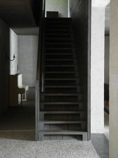 "Similar looks as ""Big Hills"" staircase, the dark colour and the light at the end of the room draws the visitor, and directs them."