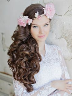 long black wavy wedding hairstyle with pink flowers / http://www.deerpearlflowers.com/25-incredibly-eye-catching-long-hairstyles-for-wedding/