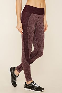 A pair of seamless marled knit leggings with ribbed side panels and moisture management.