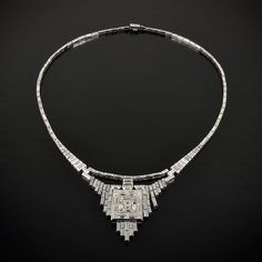Rare Art Deco diamond and platinum necklace, with a large 6ct center stone. Circa 1920s.