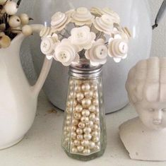 Craft: white button flowers in salt shaker with beads