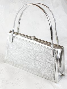 1960's Silver Handbag by JannesVintage I KNOW my mother had this same bag that I played with! Matching shoes too :)