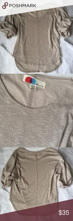 Free People Beach Sweater! Free People Beach! Slouchy Tan sweater with rolled sleeves! Excellent condition! Never worn! Size XS but with the slouchy style could work for a small too!  Slight hi low style! 24.5 inches long in the back front 21 inches long! Free People Sweaters Crew & Scoop Necks