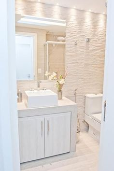 Love this white Bathroom and texture of the walls. Perfect lighting and Fixture decor and flooring.
