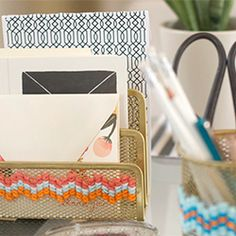 Yarn and inexpensive mesh desk supplies make for a chic office.