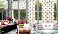 Prestigious Textiles - Jubilee Fabric Collection - Stylish conservatory in florals, checks and stripes - cushions, blinds and curtains in greens, pinks, blues and cream