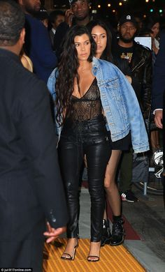 Show of support: Kourtney Kardashian was also in attendance to support Kim at the concert. Behind her is Kim's assistant