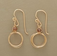 "Wire earrings gold with a glass bead. Dainty 14kt goldfilled circles loop and loop, basking in the halo effect of a lone andalusite bead. Handmade in USA. 1-3/8""L. $68 by vivian"
