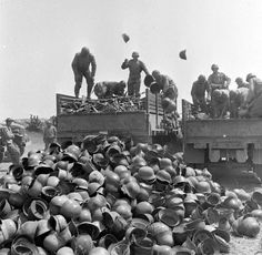 Photo after Axis Surrender in circa 10 May 1943. Piles of German Helmets surrendered