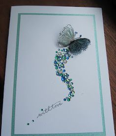 Make a rainbow tail! Or just clear diamonds on a coloured card with a white butterfly.