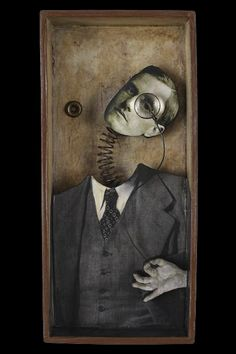 The Inspector | Artist Kass Copeland | Mixed Media Assemblage - Vintage family photo of Leon A. Dickinson on wood cutout, spring, magnifying glass, grommet
