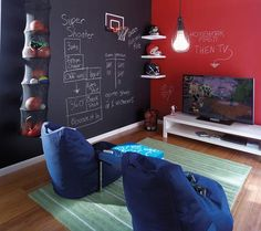 Multi-Coloured Chalkboard  Chalkboards aren't always black. Check out the cool red wall in this room example. I'm a firm advocate for chalkboard walls and think they are such a great learning tool for toddlers!