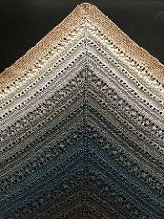 Whiskey Glass Shawl is a simple triangular shawl worked top down, using basic stitches to make the textured output. It's like an old crystal glass set on the table of your cigar salon.