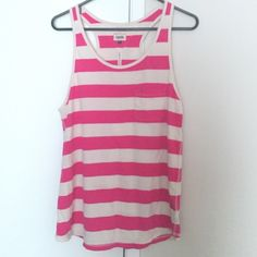 Tommy Hilfiger tank top A nice striped tank top. Brand new never worn, tags missing. Fabric is as soft as a feather. Perfect for summers. The colors are super cool Tommy Hilfiger Tops Tank Tops