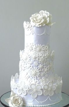 lace cut wedding cake  by Fainazcakes - http://cakesdecor.com/cakes/280405-lace-cut-wedding-cake