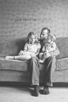 lifestyle photo of daddy with two young daughters