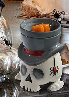 The Undertaker Horror Style Wax Warmer HalloweenForevermore.com http://www.amazon.com/dp/B00NG3IA64/ref=cm_sw_r_pi_dp_DpSyub0VWPQ7E