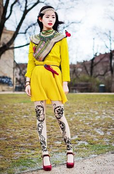 It amazes me that such an intricately detailed and complex outfit could be comprised of just a few pieces and I just love how this vibrant yellow look is punctuated by traditional Miao prints, dramatic heels, and clip-on butterflies.