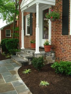 Front steps made of stone make a nice addition to any home #landscaping