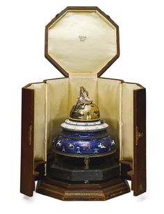 GÜBELIN AND ALFRED HOF A VERY RARE AND INTERESTING GILT SILVER, BRASS, ENAMEL AND MARBLE ANNULAR DESK TIMEPIECE CIRCA 1930