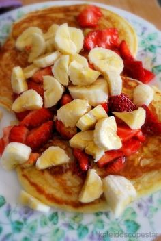 chopped banana and strawberry over pancakes