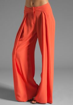 "SEE BY CHLOE High Waisted Wide Leg Pant in Orange  In what world are these ""high waisted""?  Generally the waist is above the navel, these looks like hip-huggers"