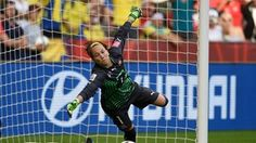 Goalkeeper Gaelle Thalmann of Switzerland dives the right way but can't stop the penalty from Aya Miyama of Japan