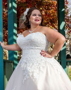 This lace embellished wedding gown flatters the curvy bride.  Elegant plus size #weddingdresses can be made with an a-line shape or ball gown frame.  We offer totally custom bridal gowns (as well as inexpensive #replicas of couture dresses that may be out of your price range).  See other strapless #plussizeweddingdresses that can be customized to your liking at www.dariuscordell.com