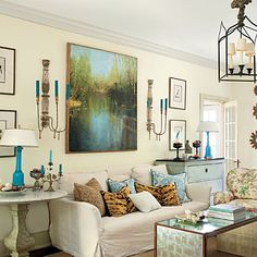Pretty, neutral living room with pops of blue and green. | SouthernLiving.com