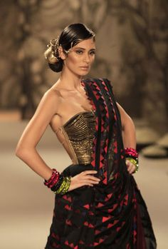 indian designer Haute Couture | displays a creation by Indian designer Rohit Bal during Delhi Couture ...