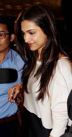 Deepika Padukone spotted at the Mumbai airport leaving for IIFA Awards 2014.
