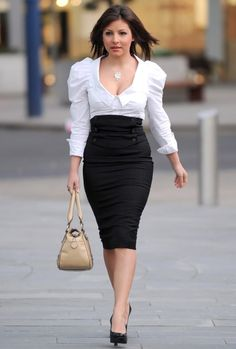 Emmerdale actress Roxanne shows that a black pencil skirt with a high waist can really flatter curves. Teamed with a puffy sleeved blouse, t...