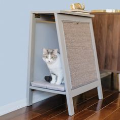 Versatile and chic, the A-Frame Cat Bed is a stylish end table for you and a comfortable bed and scratcher for your cat. Crafted from solid wood, fabric, and sisal. Heated Cat Bed, Cat Cages, Cat Perch, Cat Scratching Post, Wooden Cat, Cat Scratcher, Cat Condo, Cat Furniture, Furniture Online