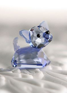 """Swarovski Lovlots Coco - I wrote a letter to Swarovski suggesting that they create a little long-haired chihuahua figurine and possibly make it """"blue"""" after Smokie (my blue chihuahua).  Shortly thereafter, little Coco showed up in the Lovelots collection.  Coincidence???"""