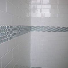 Simple Subway tile with a band of colored penny tile, all with white grout makes a clean and fresh shower option. Note that the floor that isn't visible is the aqua penny tile in this shower. Perfect for kid bathrooms + budget friendly. I'm sharing ideas on how to use these easy to find and relatively inexpensive tiles in chic and design happy ways this weekend. Come over and tell me which styles you like the most! #tile #interiors #design #showerremodel #bathremodel