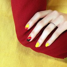 The German flag gets a geometric reworking in high gloss red, yellow, and black. Sally Hansen Black Out painted over layers of RGB Too Red and Sally Hansen Mellow Yellow.  NOW DO I HAVE BLACK NAILPOLISH...