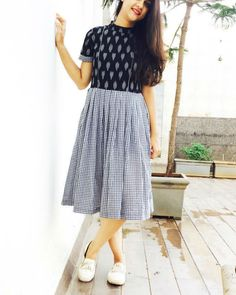 Black ikat and checks fusion dress is part of Casual frocks - Featuring a fusion of ikat and pleated gingham with invisible back zip Salwar Designs, Kurta Designs Women, Kurti Designs Party Wear, Short Kurti Designs, Simple Kurti Designs, Kalamkari Dresses, Ikkat Dresses, Frock Fashion, Fashion Dresses