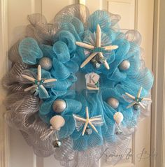 Coastal Christmas Wreath adds a beachy feel to  holiday decor. It's all about the little details.