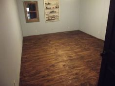 Put down plywood stain tape off paint black and white for Cheap diy flooring ideas