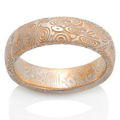 Chris Ploof - Naked Damascus ring, Twisted pattern with 24 karat gold wash, rounded top.